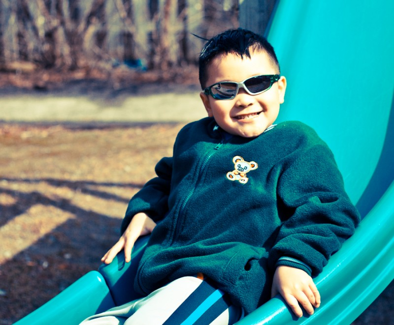 Rummie - Asian Boy on Green Slide with Sun Glasses