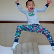 Boy Jumping on Bed with Pajamas