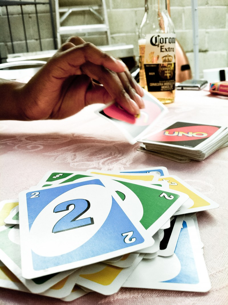 Playing Uno - Hand Holding Card