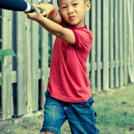Boy Swinging a Bat