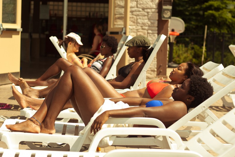 Black Females Laying Out by the Pool