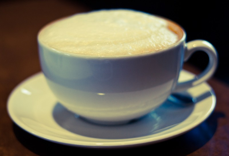 Latte in white cup and saucer